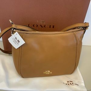 Coach purse Luggage is the color